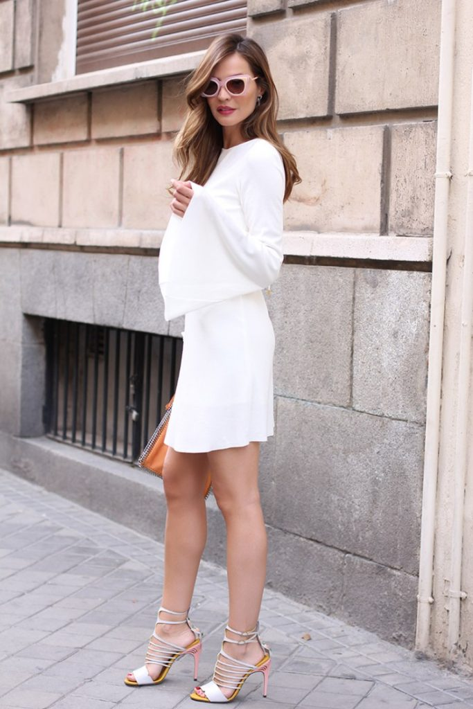 White Outfits For Summer: Silvia Garcia is wearing a long sleeved white Zara dress