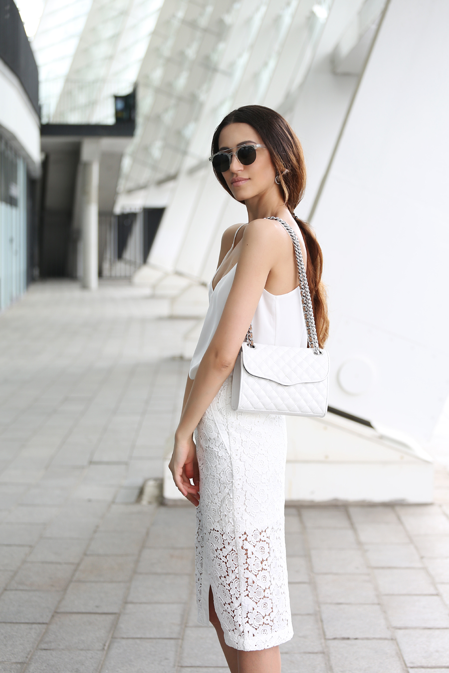 Tina Sizonova in a white lace midi skirt and a white cami top accessorised with a sidebag Skirt/Top: Love Republic, Bag: Rebecca Minkoff