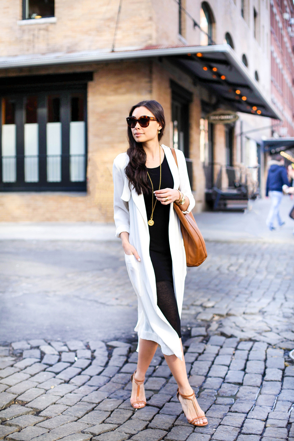 Draped Trench Fashion Trend: Kat Tanita is wearing a creme Cynthia Vincent draped trench coat