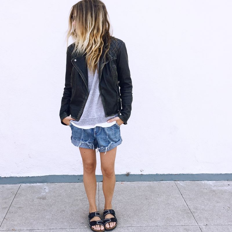 Laura Wiertzema is wearing an All Saints leather jacket, denim cut off shorts and black studded Birkenstock sandals