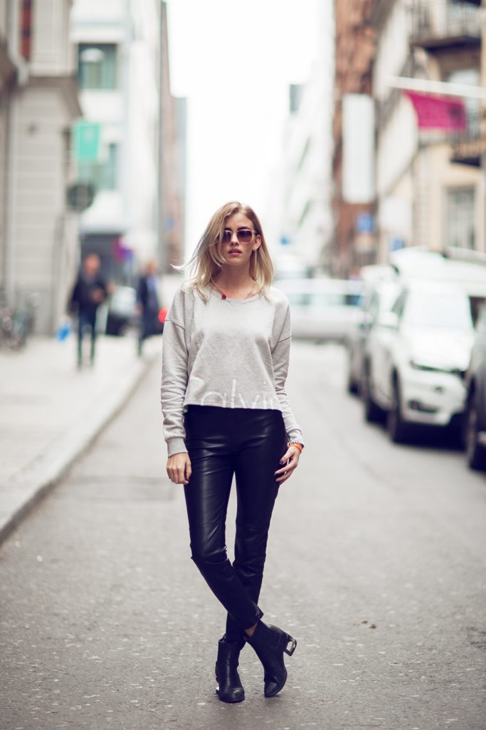 Street Style Via Just The Design: Elsa Ekman is wearing a cropped Calvin Klein sweater, leather Zara trousers and Henry Kole black ankle boots