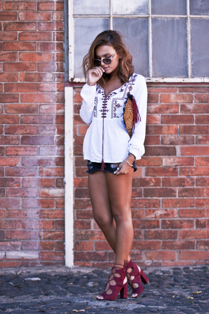 Mafalda Castro is wearing cute bohemian blouse with strappy maroon heels and trendy denim shorts.  Blouse: SuiteBlanco, Bag: SuiteBlanco, Shoes: Public Desire.