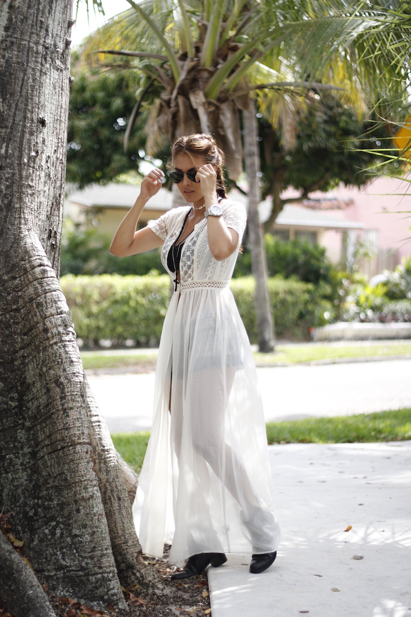 Nicholl Vincent is rocking a classic floaty dress in sheer white here, creating a gorgeously bohemian silhouette which is perfect for summer wear! Worn with a bralette and ankle boots, this look is elegant and sexy. Outfit: Target.