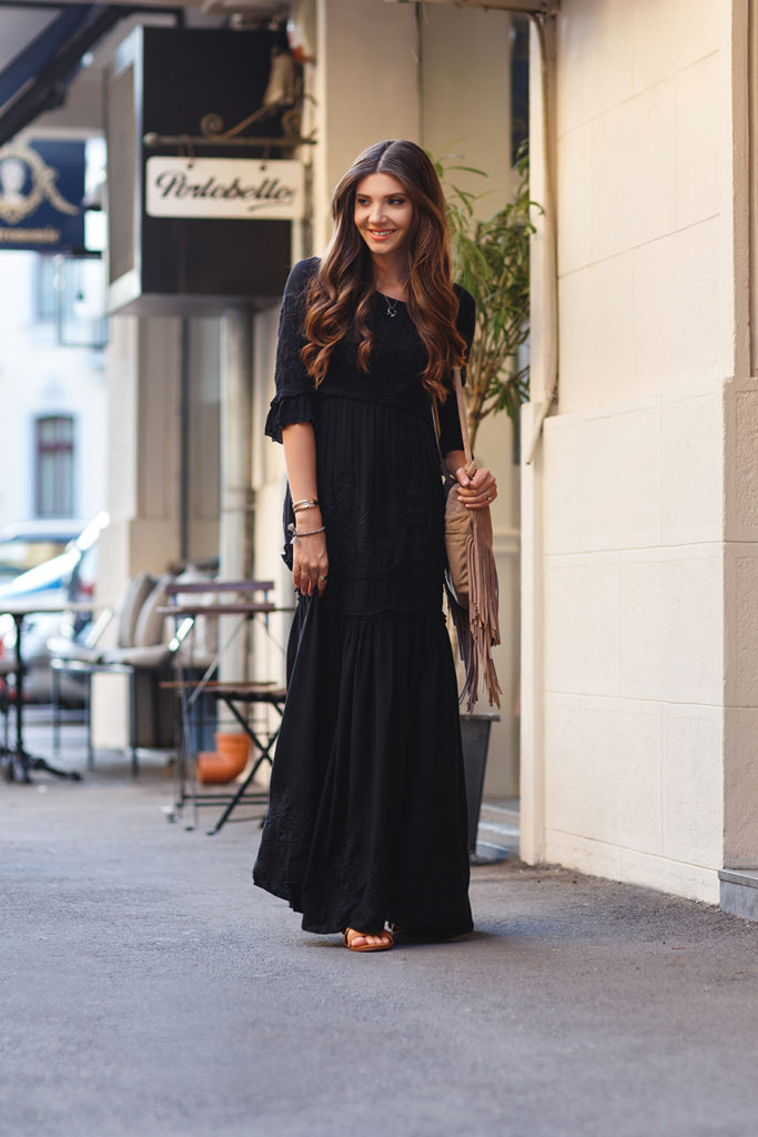 Larisa Costea rocks this floor length black laced dress. Pair with a fringed leather bag for the ultimate boho look.   Dress/Sandals: Choies, Bag: Lulu's.