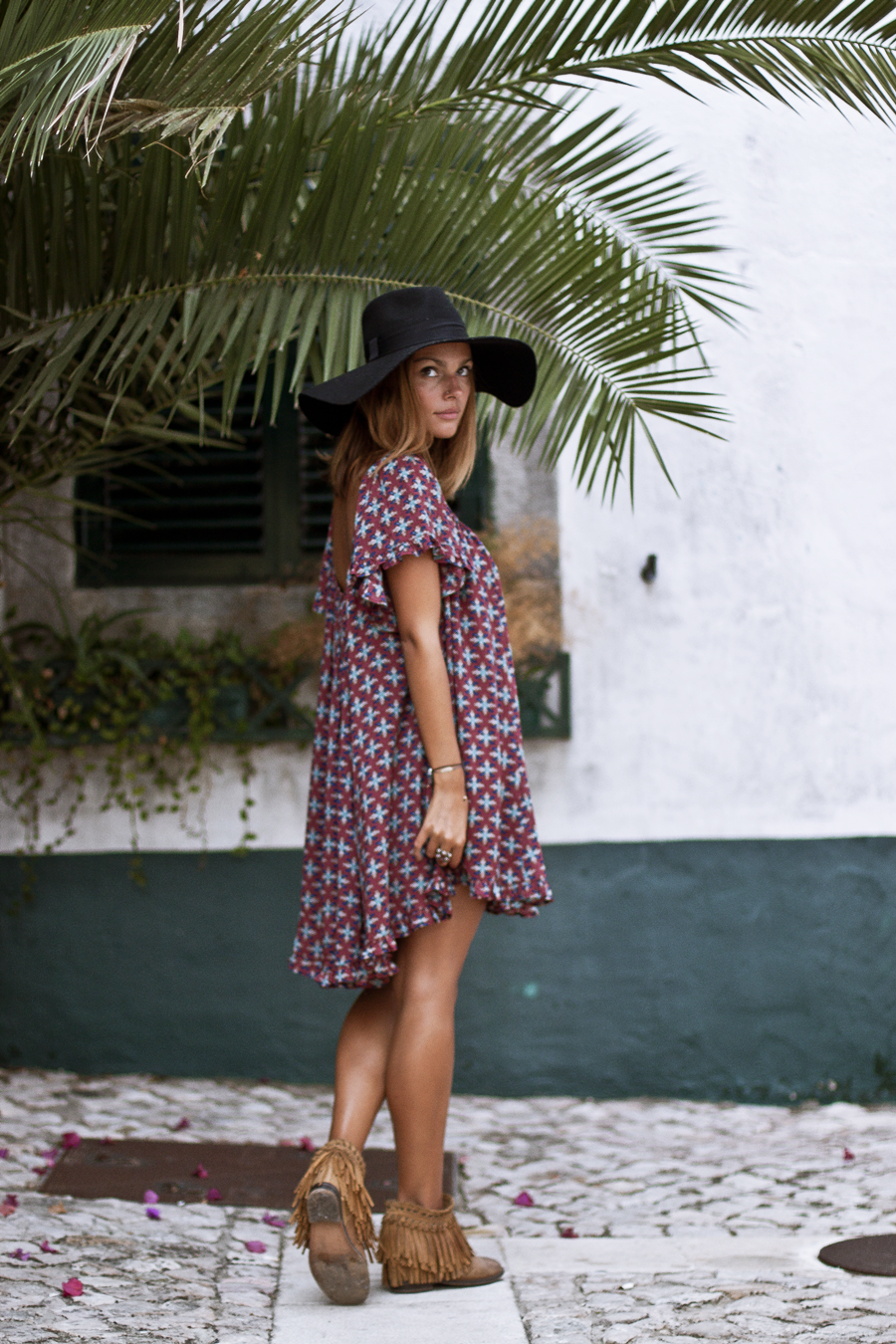Mafalda Castro is wearing cute boho midi dress with fringed leather ankle boots and a wide brimmed hat. Dress: Mary G World, Boots: Zara.