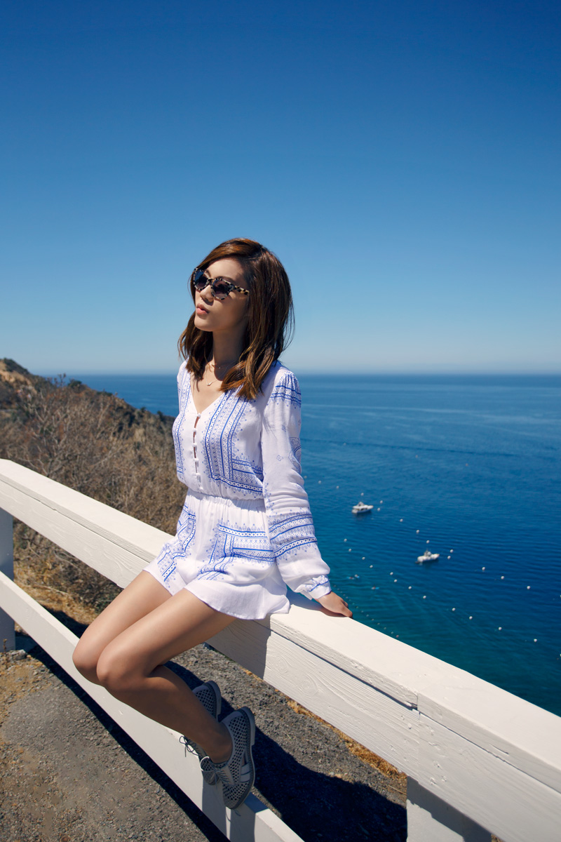 Jenny Tsang is looking super cute in this blue and white playsuit, a perfect depiction of contemporary boho chic! A playsuit like this is an ideal choice for those days where you want an alternative to a classic dress. We love this fun and flirtatious style! Playsuit: The Jetset Diaries, Sunglasses: Made Eyewear, Shoes: Miista.