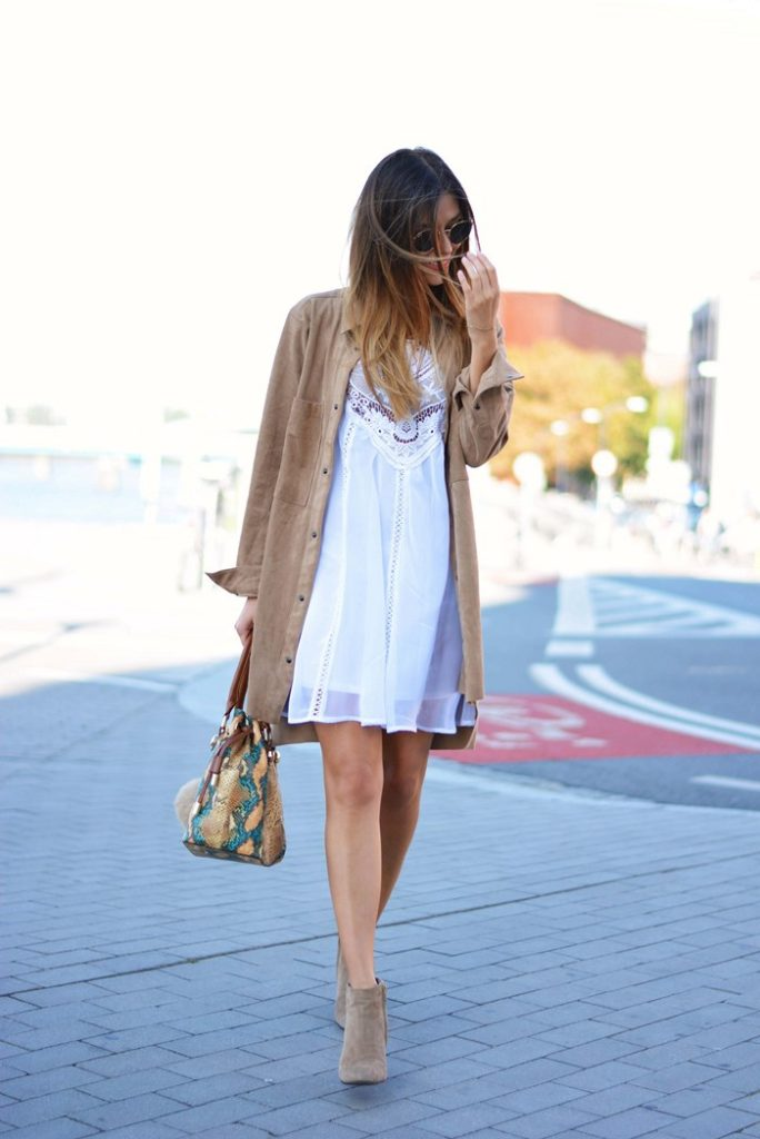Try wearing an oversized suede shirt over a simple white lace dress for an easy boho look. Via Magda.  Dress: Tutaj, Shoes: Prima Moda.
