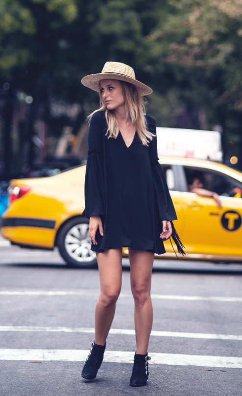 For a simple but classic bohemian style, try wearing a short fringed dress witha pair of funky ankle boots like Rebecca Laurey. Add a straw hat for that extra degree of authenticity! Dress: Zara, Boots: Toga Pulla, Hat: Lack of Color, Bag: Claris Virot.