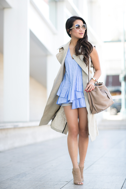 Street Style Fashion: Wendy Nguyen is wearing a beige Theory vest and blue pleated Marissa Web top paired with Aquazzura heels and a Mulberry handbag