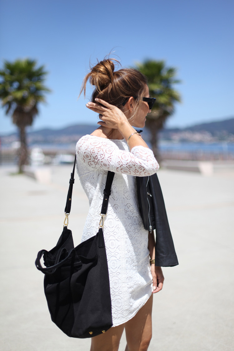 Probably the easiest way to pull off a white lace dress outfit is to accessorise it with a black bag and a black moto leather jacket. That works. Via Silvia Garcia Dress/Bag: Sézane