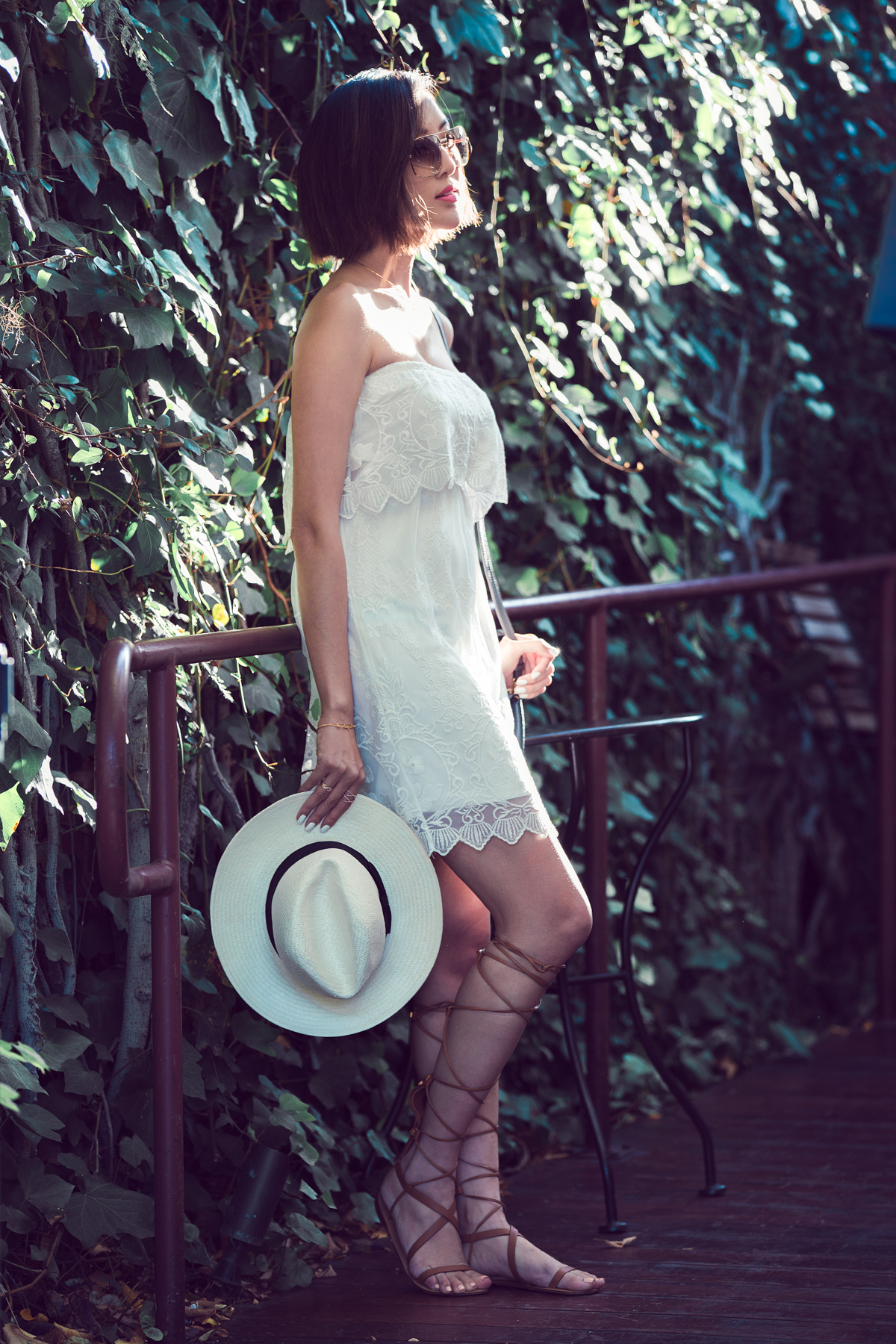 Add a matching panama hat and lace up's to your lace dress and you are good to go. Via Chriselle Lim Dress/Hat: Express, Shoes: Valentino