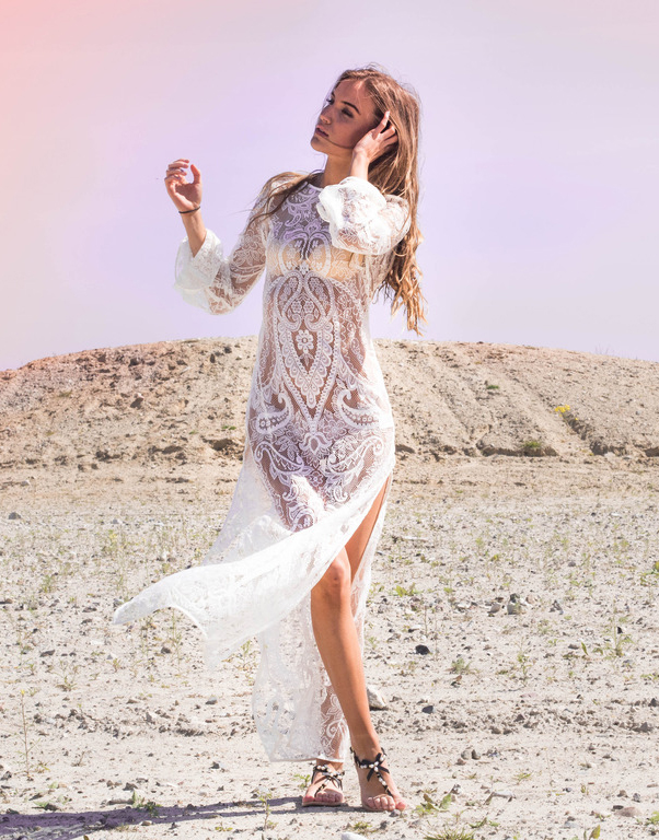 If you are a bit more daring you could opt for a somewhat see-through lace dress. This works particularly well on the beach. Via Sandra Willer  Dress: H&M