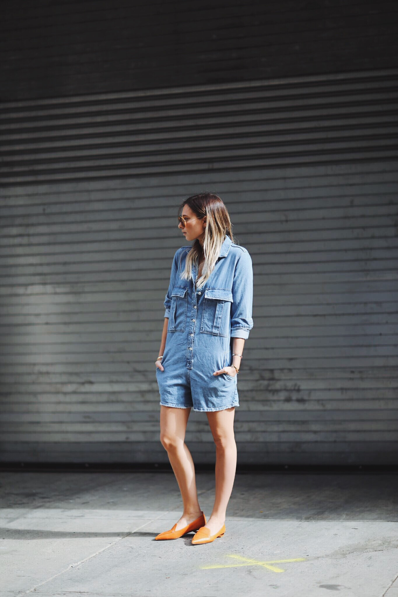 Street Style: Danielle is wearing a denim jumpsuit with beige pumps