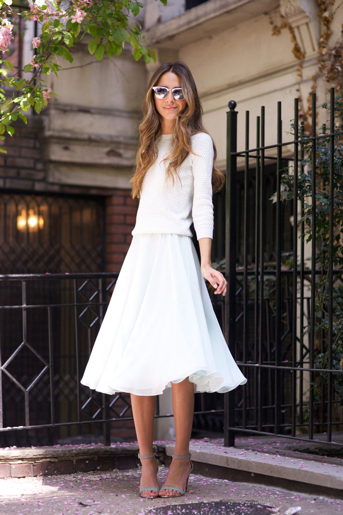 Street Style Fashion: Arielle Nachami is wearing a pastel blue skirt, heels and a white sweater all from Ted Baker