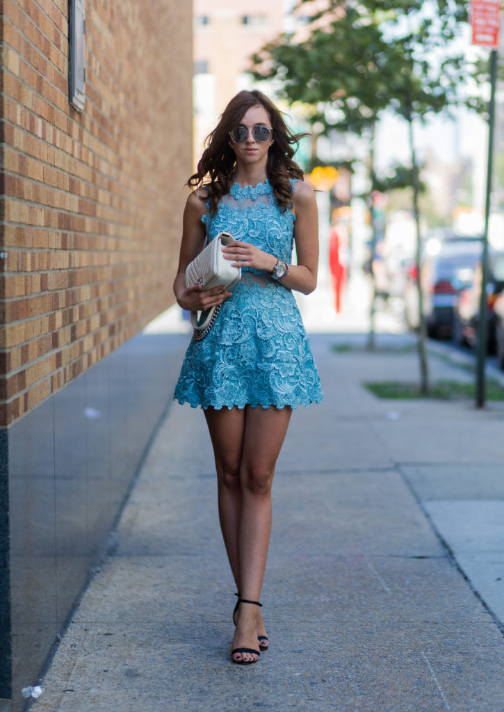 Barbora Ondrackova is absolutely killing it in this gorgeous sky blue dress with lace detailing. Paired simply with black sandals and a white clutch, this outfit is perfect for any summer occasion.   Dress: Topshop, Heels: Asos, Bag: Chanel.