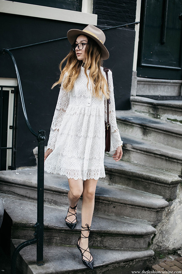 Beatrice Gutu oozes femininity in this beautifully intricate white lace dress, with button up detailing and a patterned hem. Pair a dress like this with a hat and strappy sandals to steal this wonderful style! Dress: Zimmermann.