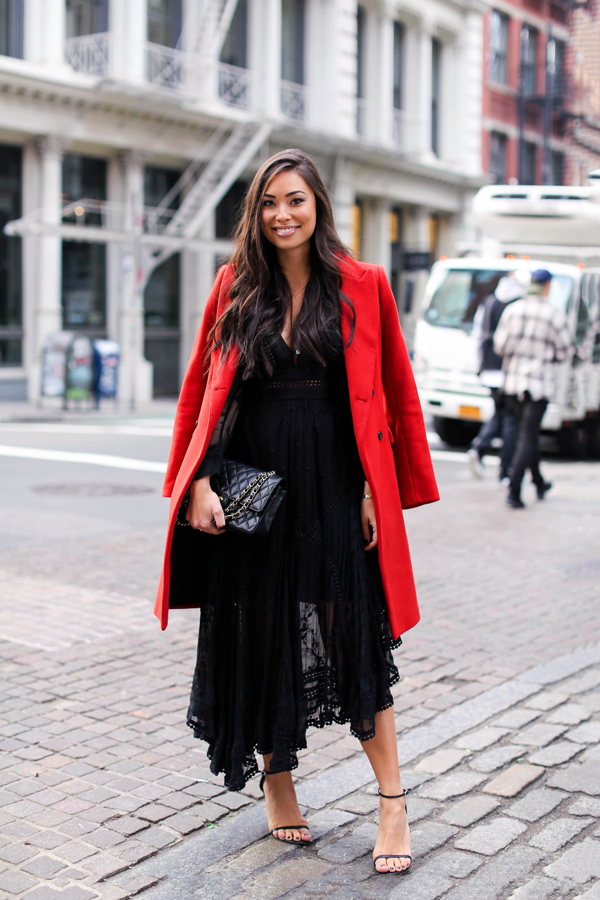 A black lace dress has it all; sex appeal, style, and the ultimate sophistication. Kat Tanita wears this black plunge neck maxi dress with a statement red mac and simple heeled sandals; a look perfect for day or night! Dress: Zimmermann, Coat: Zara, Heels: Stuart Weitzman, Bag: Chanel.