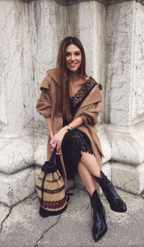 Wear a lace dress with a bunched up tan coat to steal Negin Mirsalehi's beautiful winter style. Try pairing an aztec style bag with this look to further enhance it's authenticity! Outfit: Alberta Ferretti, Boots: Philosophy.
