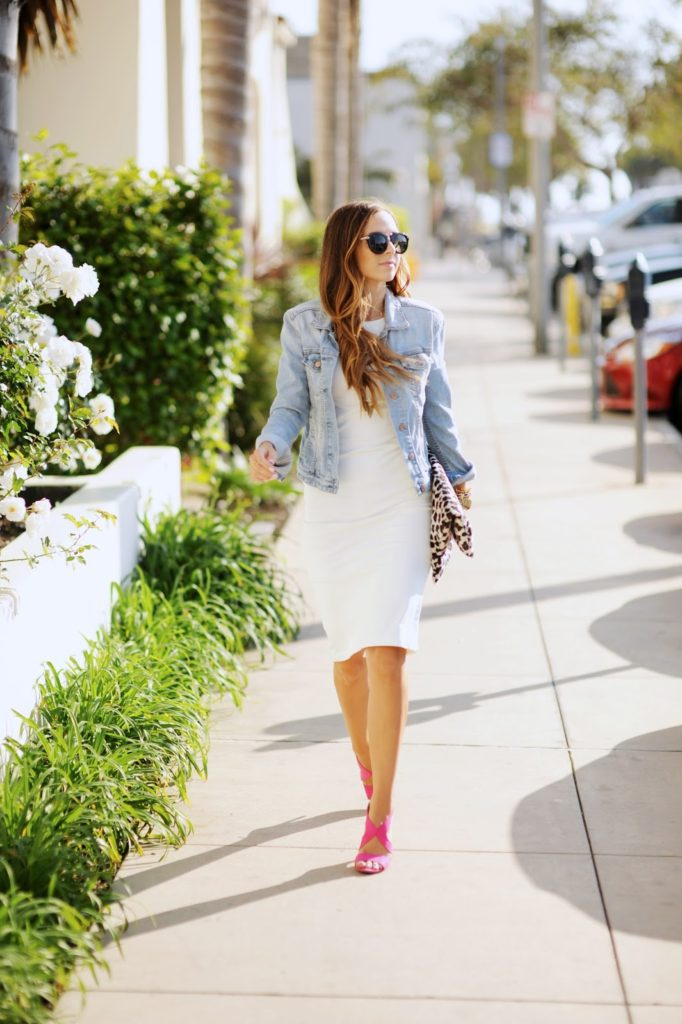 Street Style, Spring Fashion: Merrick's Art is wearing a white dress from Lulus paired with a Gap denim jacket and candy pink Rack Room heels