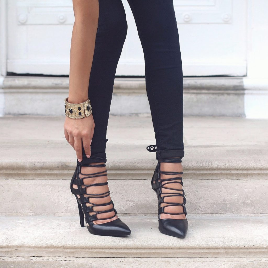 Nada Adelle is wearing a pair of black skinny jeans from Topshop with Public Desire lace heels and a gold bracelet