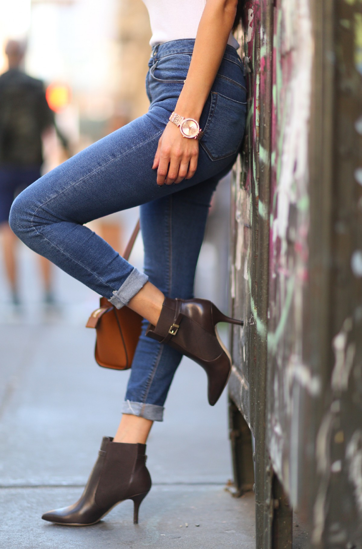 High waisted denim jeans are the perfect match with heeled leather ankle boots. Via Neginmirsalehi.com. Boots: Woods.
