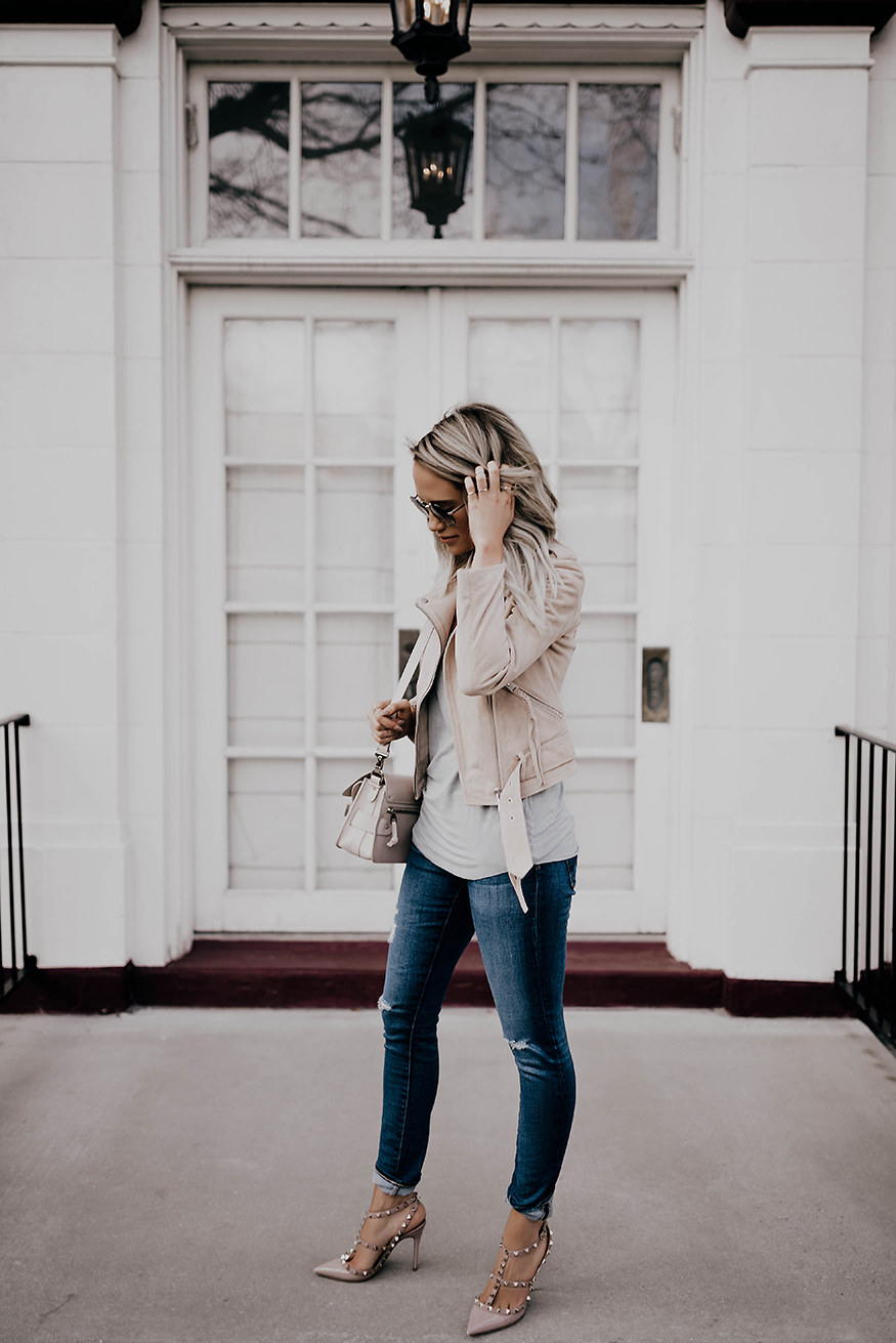 Megan Anderson is rocking skinny denim jeans with a blush pink leather jacket, mini bag, and studded pink heels. We love this casual but stylish look! Jacket: All Saints, Shirt: Paige, Denim: AG, Shoes: Valentino, Bag: Proenza Schouler, Sunglasses: Prada.