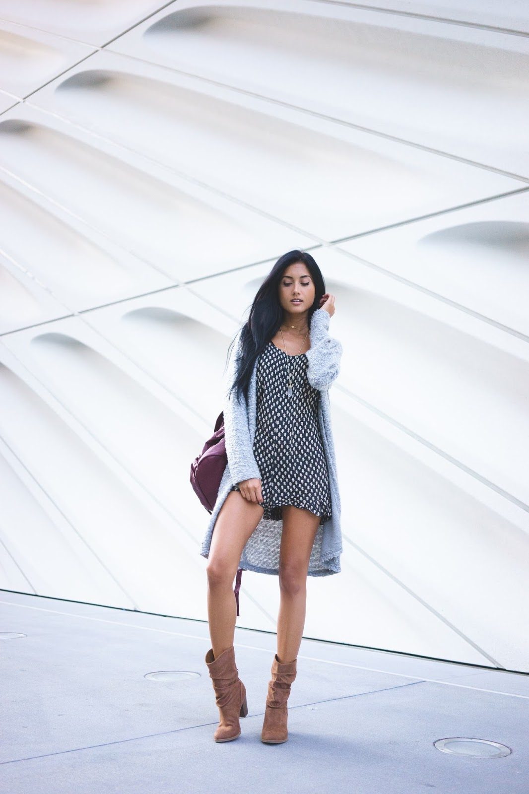 Racquel Natasha rocks these cute leather boots with a mini dress and long cardigan. Boots: Indigo Road.