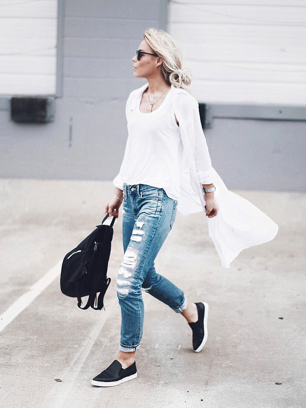 Perfect for a warm spring day. Long white shirt over ripped jeans with a pair of black slip-ons. Via Mary Seng Shirt: Current & Eliott, Top: Leith, Jeans: AG Denim, Slip-ons: Vince