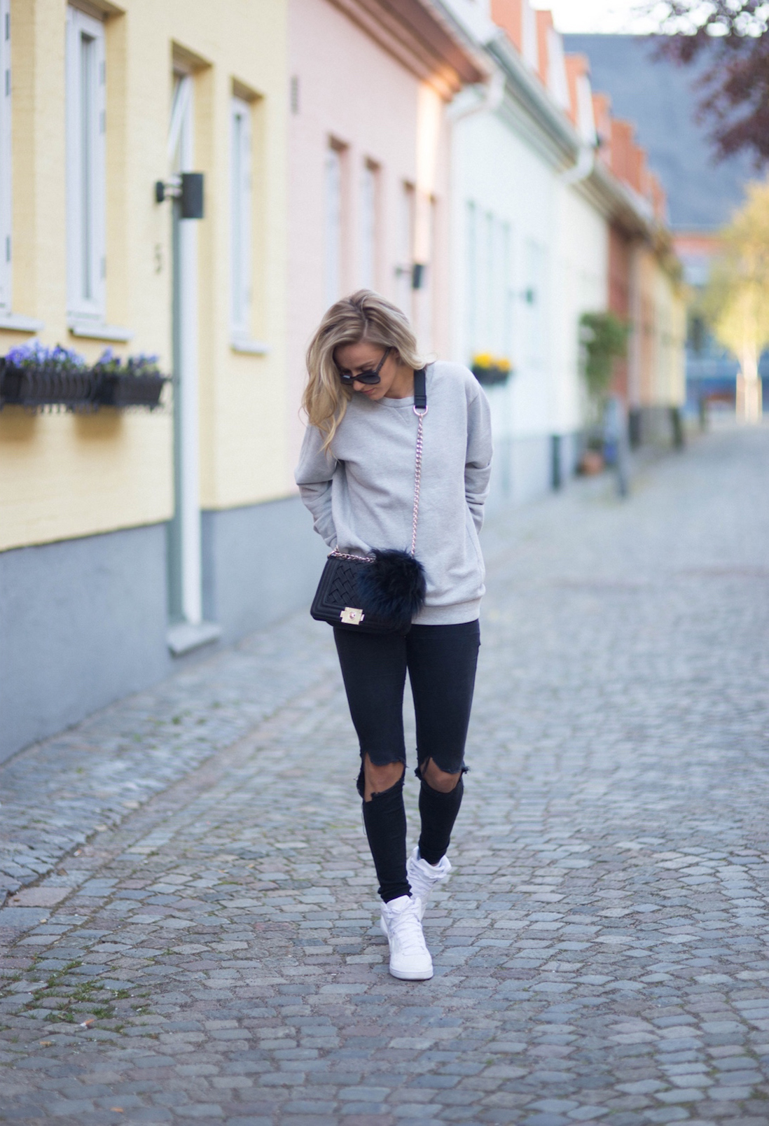 Black ripped knee skinny jeans, basket trainers and a grey sweatshirt. A simple, casual look for spring. Love the bag too. Via Sendi Skopljak Sweater: Zara, Bag: Persunmall, Jeans: Dr denim, Trainers: Nike, Sunglasses: Chanel