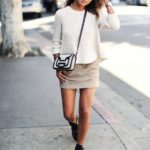 Julie Sarinana showing off the suede trend in this perfect neutral spring outfit Sweater: Madewell, Skirt: Anine Bing, Bag: Pierre Hardy, Sunglasses: Illesteva, Boots: Balenciaga