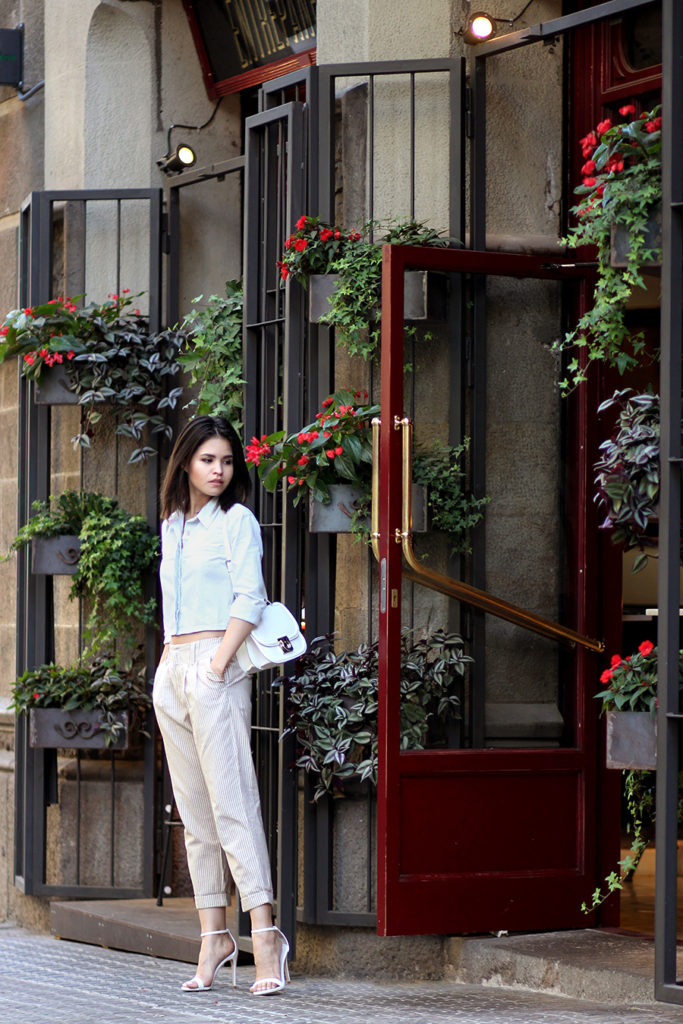 Adriana Gastélum in beige vertically striped trousers from LuLu's
