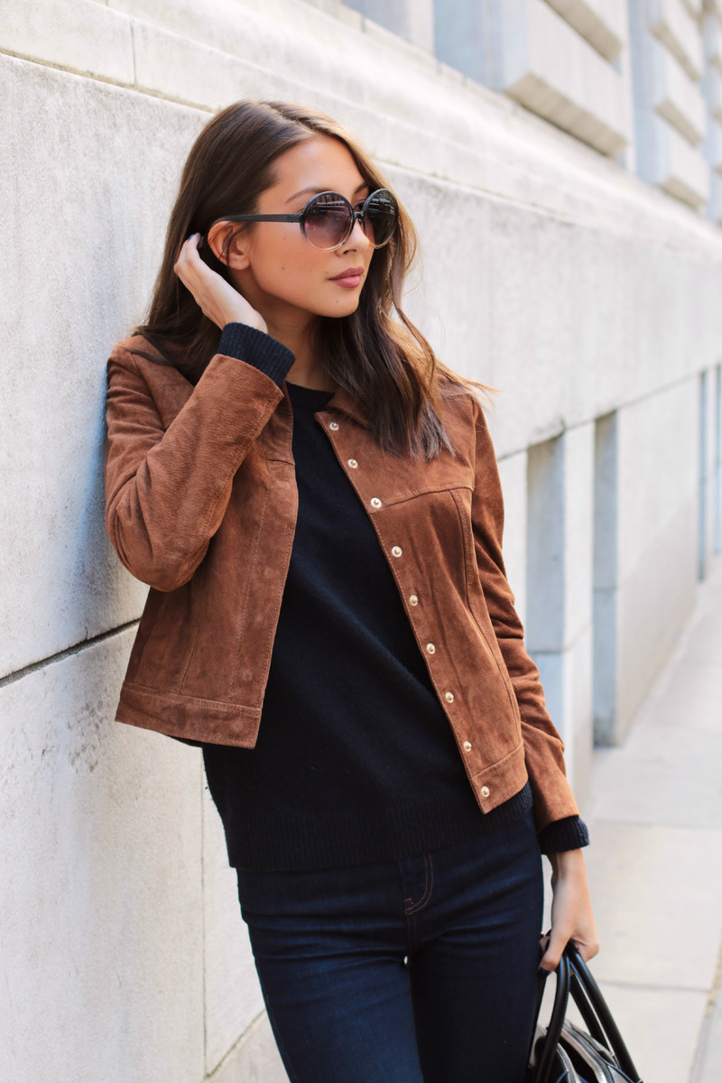 Felicia Akerstrom is wearing a suede jacket from Mango, black top from Uniqlo and jeans from Topshop and hte sunglasses are from Forver 21