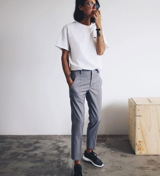 Petra is in tomboy attire here, pairing grey slacks with adidas sneakers and a white tee to create a classic boyish style.   Trousers: Jil Sander, Tee: The Undone Store, Shoes: Adidas.