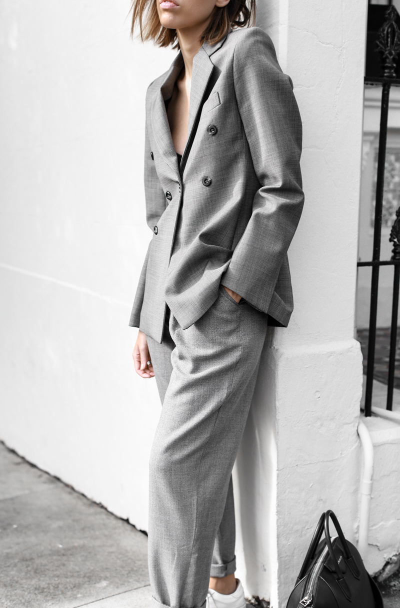 Kaitlyn Ham looks ultra dapper in this beautiful tomboy style two piece, paired with sneakers and a simple black bralette beneath the blazer. There is no look more androgynous than wearing a suit! Blazer: Ellery, Trousers: Topshop Boutique, Sneakers: Wings + Horns, Bag: Givenchy.