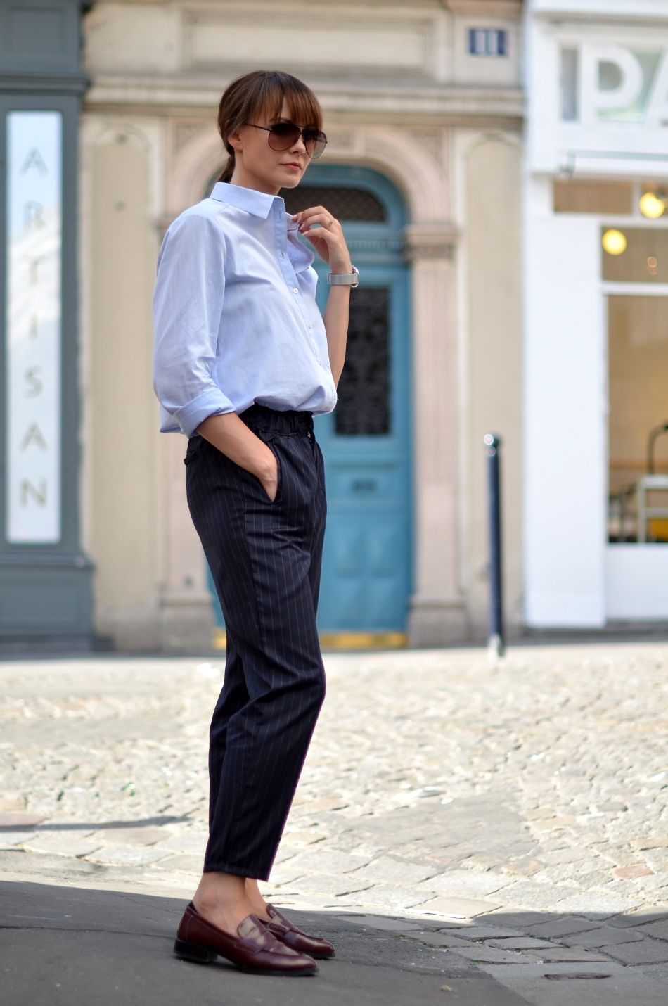 Pale blue shirt, pinstripe pants and loafers. Via Kamila Leciak Shirt: Promod, Loafers: Parfois, Sunglasses - Fossil