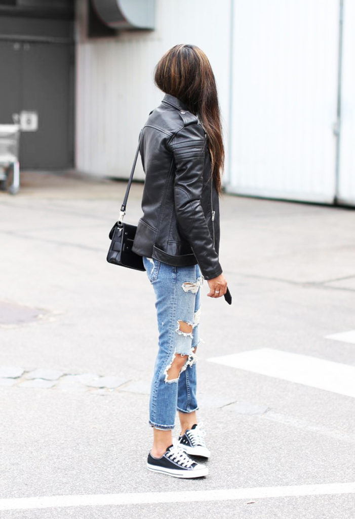 The biker jacket, ripped jeans and Converse sneakers remains in the very top of the Tomboy lookbook. Via Laura Dittrich  Jacket: BLK Denim, Sneakers: Converse Sneakers, Jeans: Zara