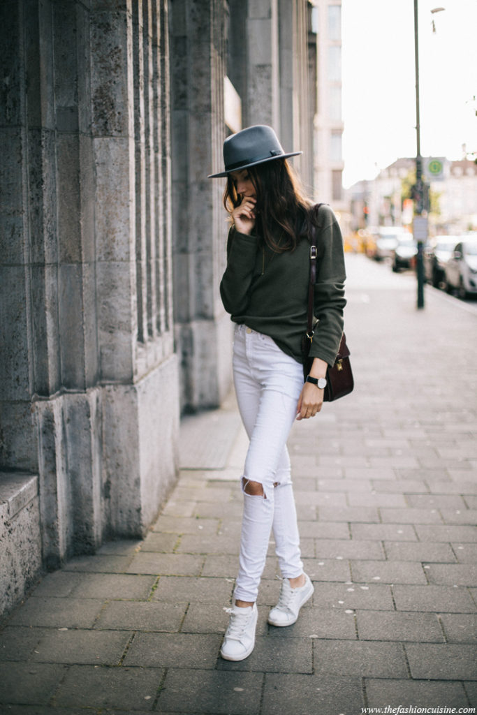 Wear a simple pair of white sneakers with your white white skinny jeans. That will always work. Via Beatrice Gutu  Sweater: DKNY, Jeans: Asos, Hat: Brixton, Sneakers: Mango white sneakers
