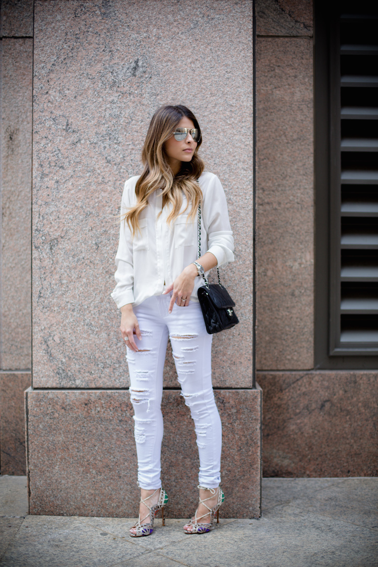 Street Style Fashion: Pam Hetlinger is wearing a pair of white Liquor & Poker distressed jeans with a Nordstrom blouse and lace up heels from Schutz