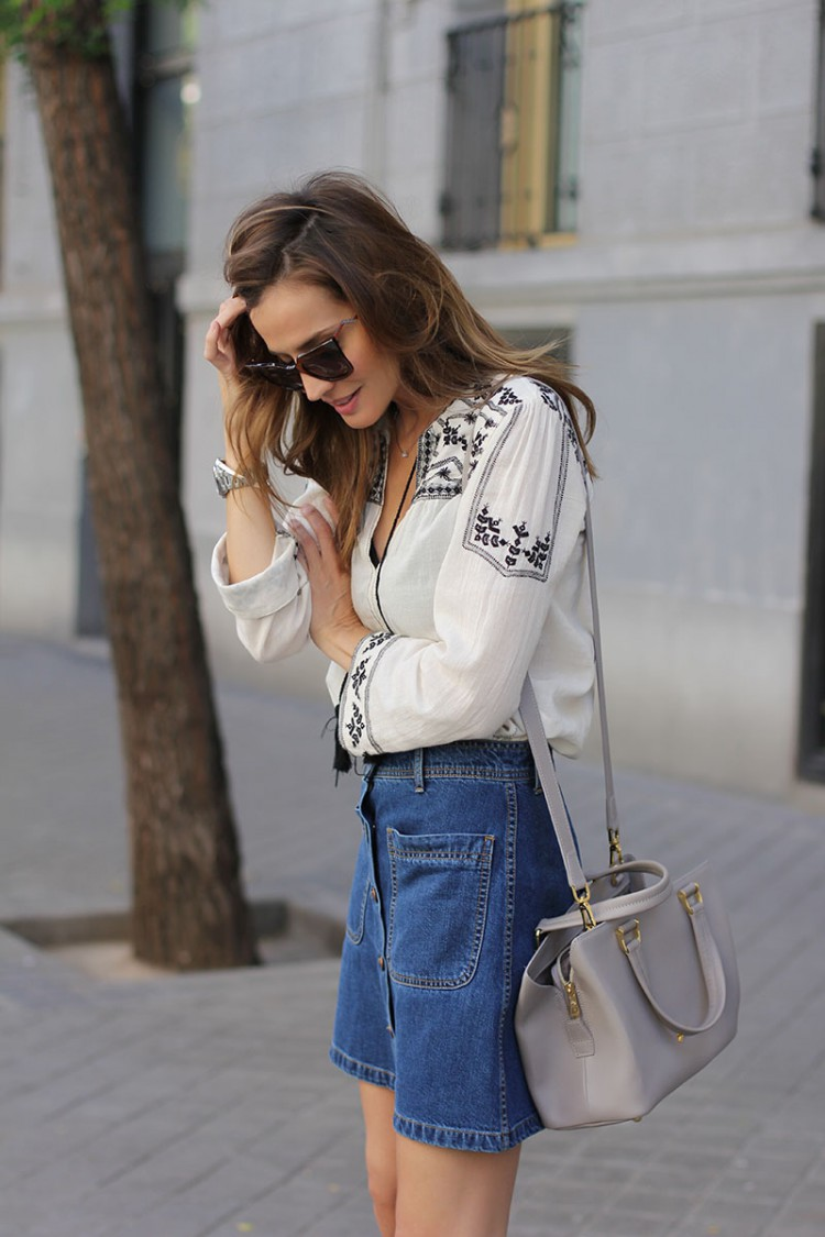 Bohemian Style Fashion: Silvia Garcia is wearing a bohemian style blouse and denim skirt from Zara