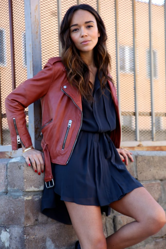 Ashley Madekwe in a cute simple spring outfit, red biker jacket and black mini dress   Jacket: All Saints, Dress: Isabel Marant