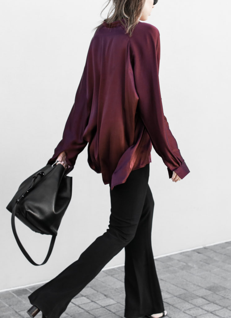 Contemporary Boho Chic: Kaitlyn Ham is wearing a retro burgundy silk blouse and a pair of black flares