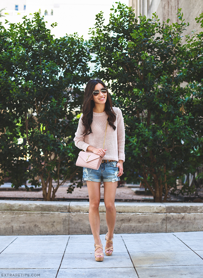 The pastel pink jumper, denim cut off shorts, heels and side bag create a super cute spring look. Via Jean Wang Jumper: Ann Taylor, Shorts: Express, Shoes: BP, Bag: YSL