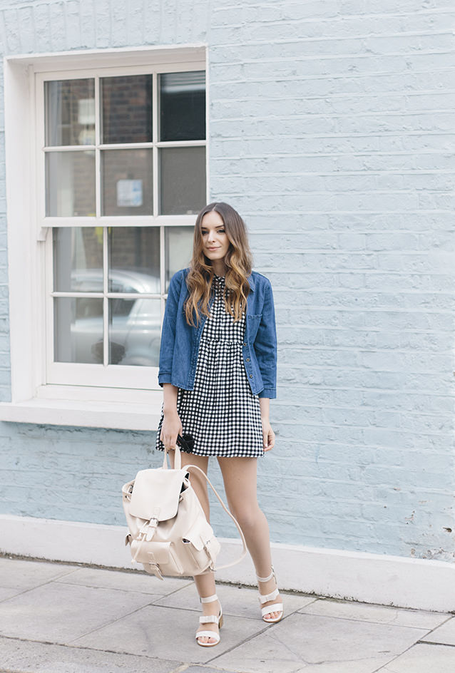 One of the greatest ways to complete a perfect spring outfit is with cute gingham dress. Via Olivia Purvis