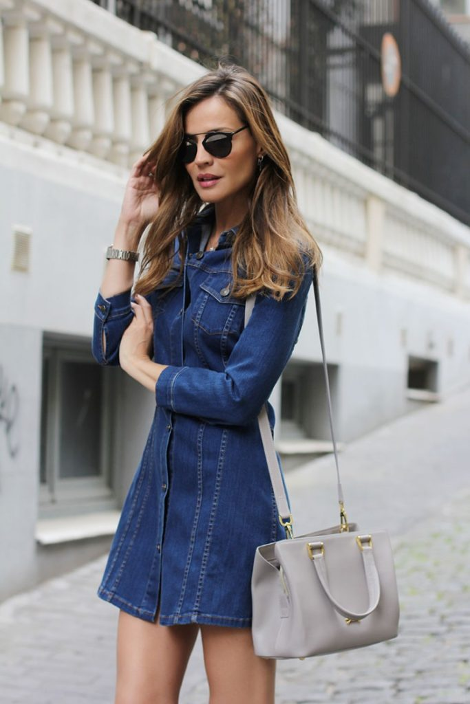 Via Just The Design: Silvia Garcia is wearing a long sleeved denim dress from Zara with a pale grey Longchamp bag