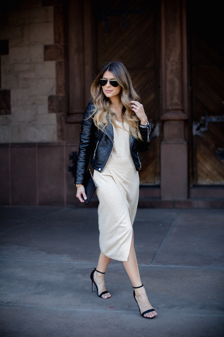 Via Just The Design: Pam Hetlinger is wearing a beige Asos midi dress paired with a Topshop faux leather biker jacket and black heels