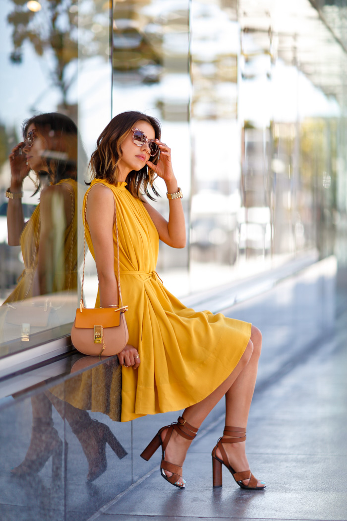 Street Style, May 2015: Annabelle Fleur is wearing a Banana Republic mustard halter neck dress