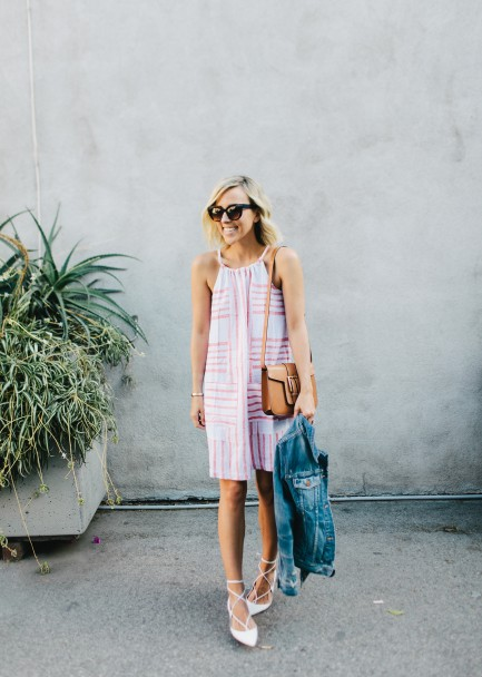 Jacey Duprie is wearing an Old Navy striped shift dress with a cropped denim jacket and white Balenciaga flats