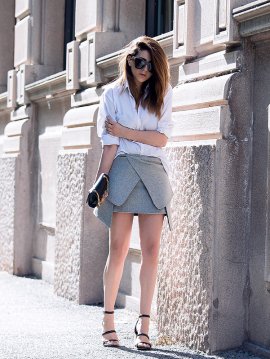 Street Style, Fashion 2015: Silvia Garcia is wearing a shirt from Zara, an ash grey Zara skirt, Senso heels and a black Saint Laurent clutch bag