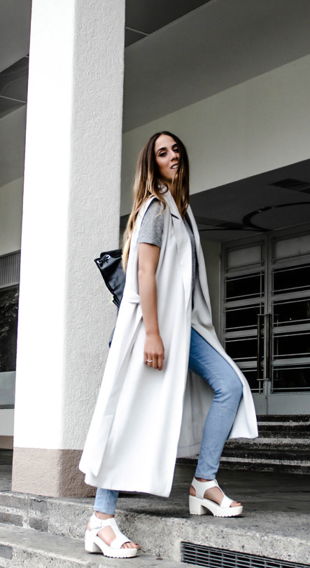 Just The Design: Alison Liaudat is wearing a  white sleeveless H&M mac coat with American Apparel skinny jeans and white Steve Madden wedged heels