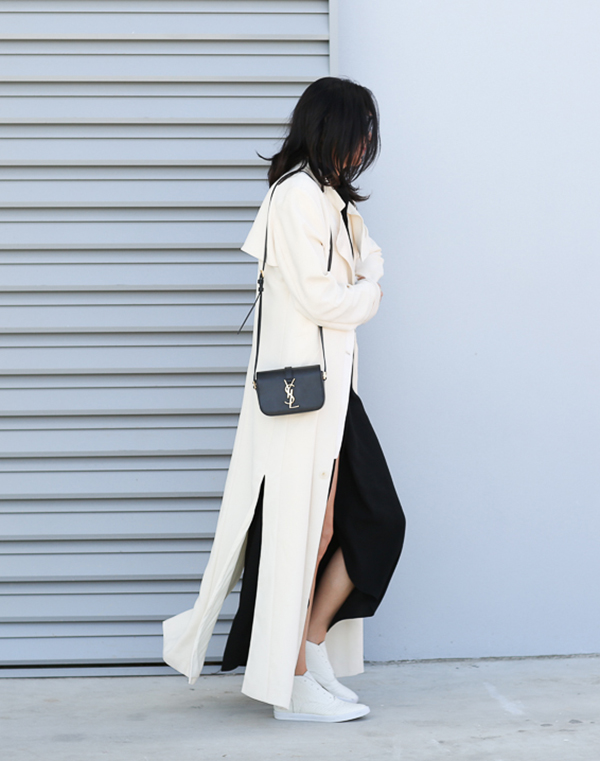 Street Style May: Fiona Edwards is wearing a  black maxi Haute Hippie dress with a creme Hunky Dory trench coat, Seed Heritage sneakers and an YSL black side bag